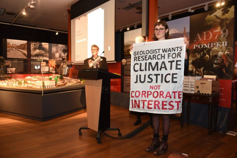 When receiving an award for exploration geophysics, Jodie dropped a banner asking for research in the public interest of climate change